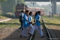 Shekhawati Express 038 - Schoolgirls hurriedly cross the tracks as a train comes into Ringus