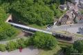 Dampfspektekal 2014 079 - Aerial view of a train emerging from the Lichtensteiner tunnel near the paper factory
